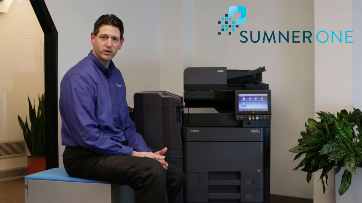Man with Kyocera printer