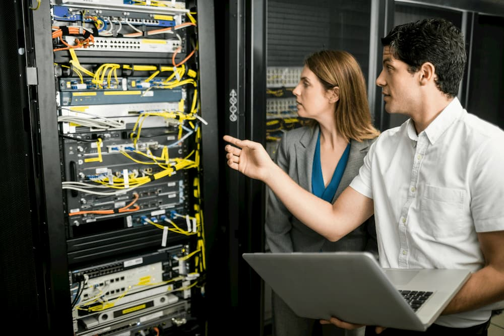 IT-professionals-working-on-server-rack