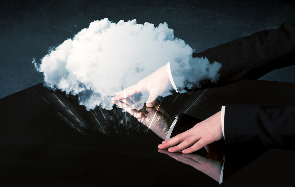 Male-hands-touching-interactive-table-with-a-white-cloud-on-it