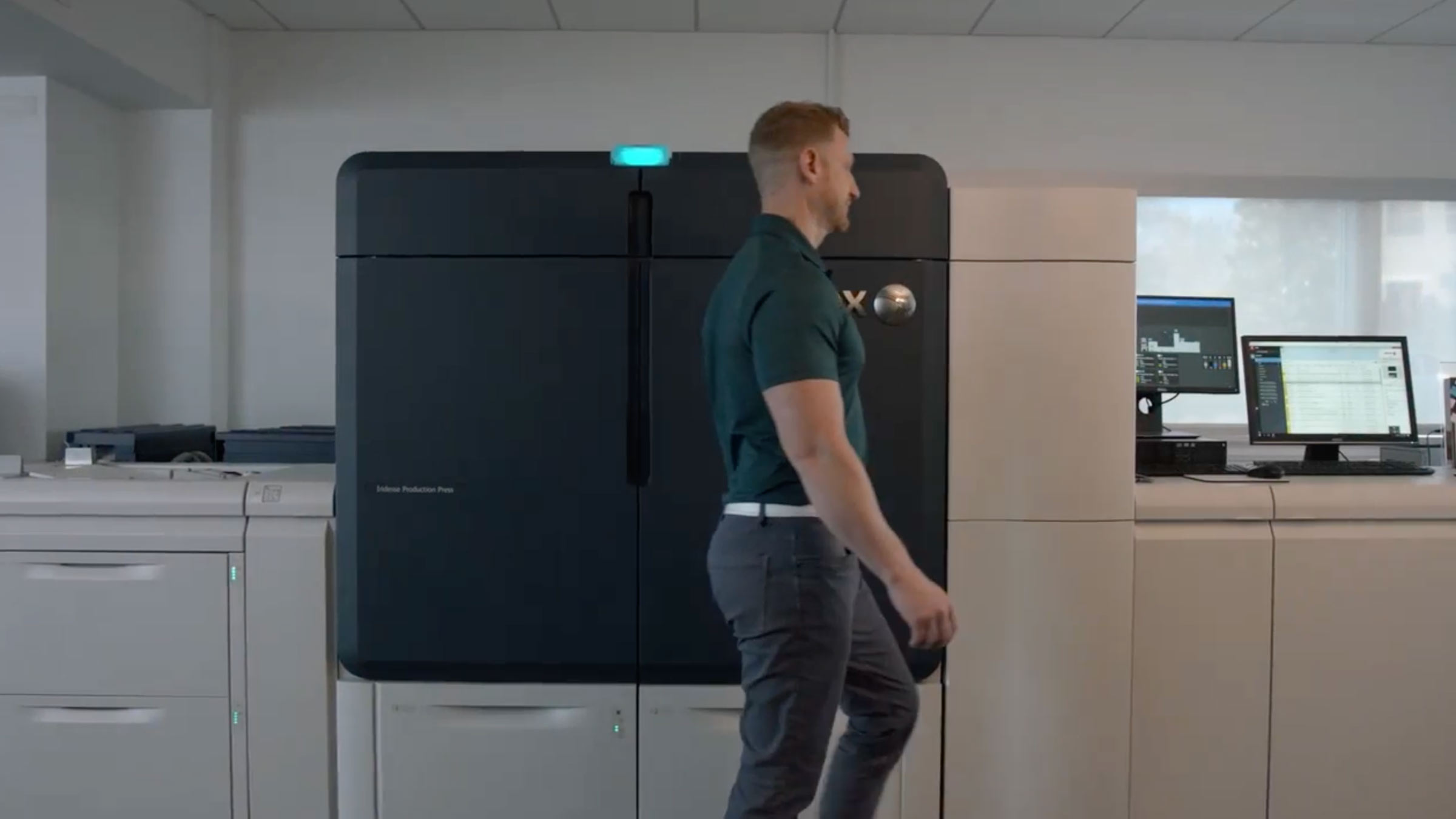 Man walking by printers