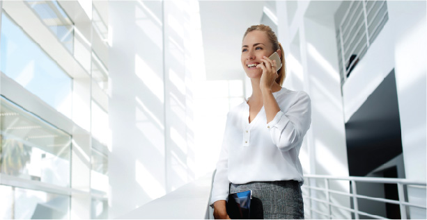Woman on phone using a Managed Voice solution from SumnerOne