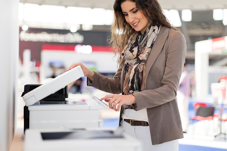 woman using scan option on a MFP in workplace
