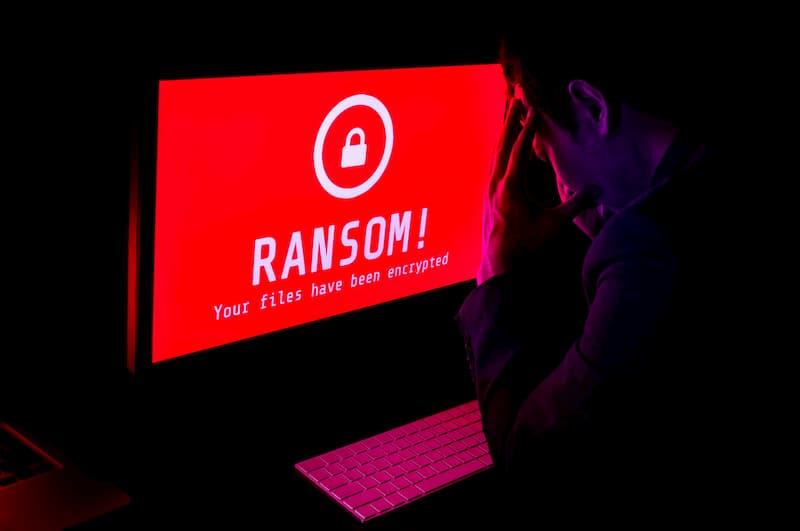 man-staring-at-computer-with-ransomware-attck