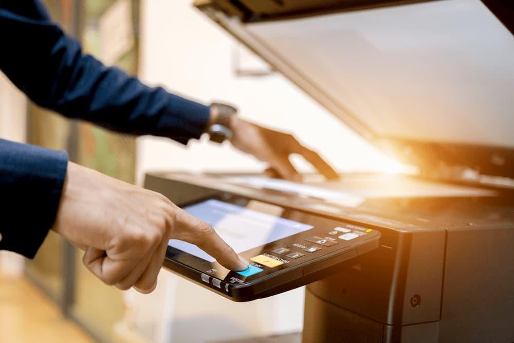 close up of man using a copier