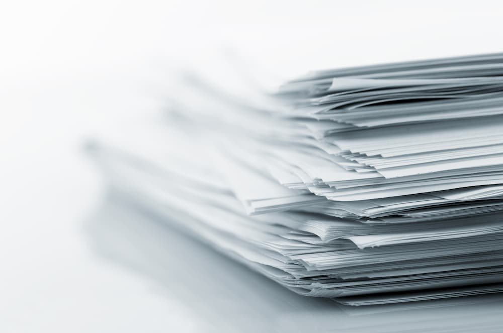 stack of printed papers